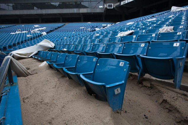 What appears to be leftover sand covers half of these seats.