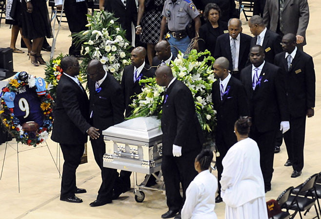 Courtesy of the USA Today: Members of the Baltimore Ravens raise McNair's casket at his funeral.