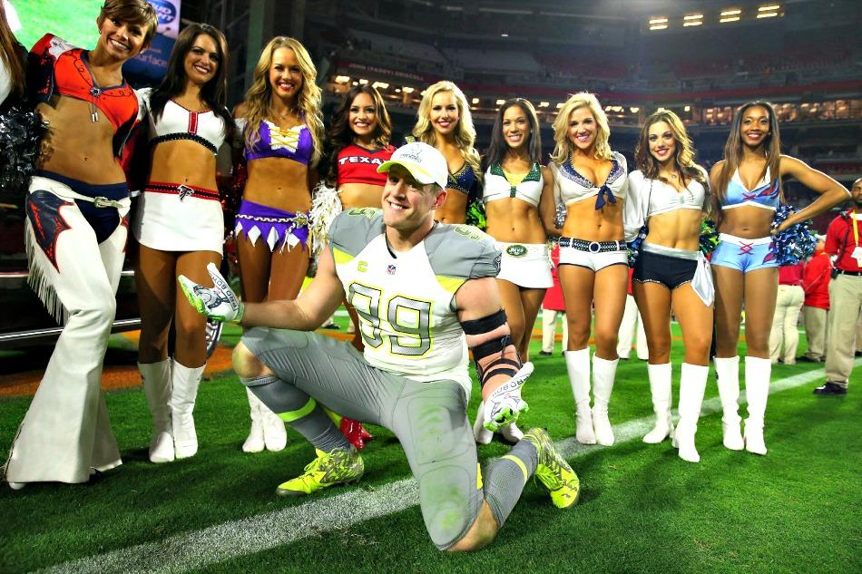 Jan 25, 2015; Phoenix, AZ, USA; Team Carter defensive end J.J. Watt of the Houston Texans (99) poses with the NFL cheerleaders after the 2015 Pro Bowl at University of Phoenix Stadium. Mandatory Credit: Mark J. Rebilas-USA TODAY Sports