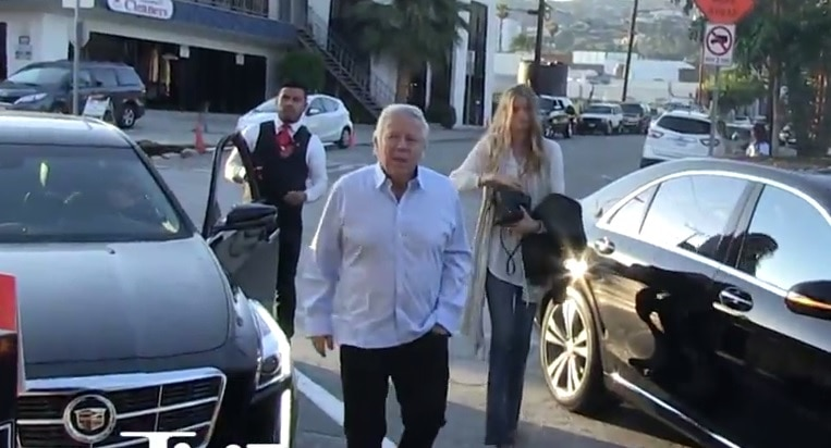 watch robert kraft signs autographs while out on date. Black Bedroom Furniture Sets. Home Design Ideas