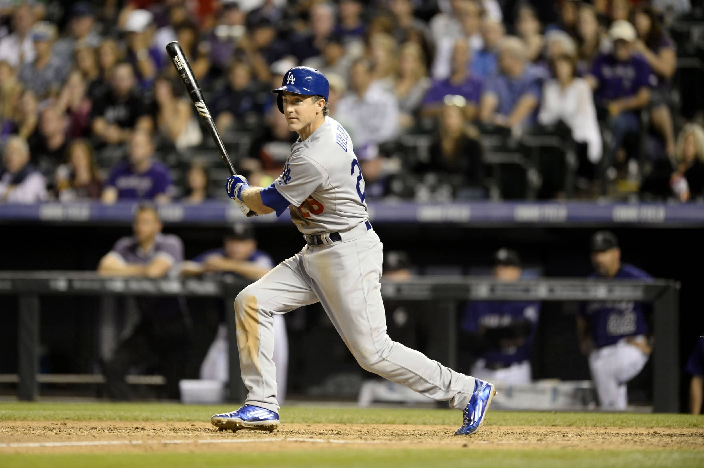 Sep 25, 2015; Denver, CO, USA; Los Angeles Dodgers third baseman Chase Utley (26) doubles in the fifth inning against the Colorado Rockies at Coors Field. Mandatory Credit: Ron Chenoy-USA TODAY Sports