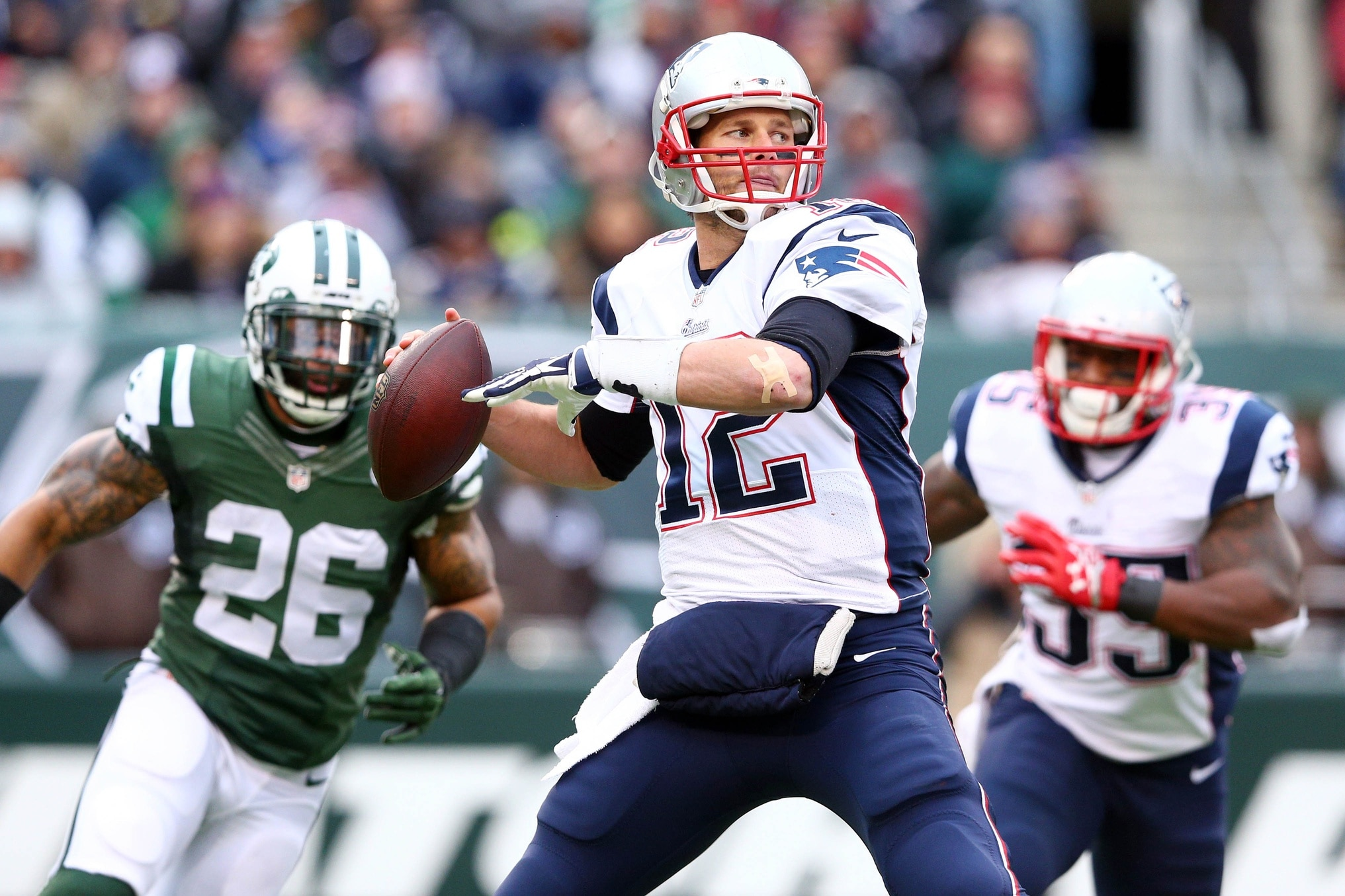 Dec 21, 2014; East Rutherford, NJ, USA; New England Patriots quarterback Tom Brady (12) drops back to pass against the New York Jets during the first quarter at MetLife Stadium. Mandatory Credit: Brad Penner-USA TODAY Sports
