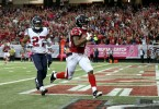 Oct 4, 2015; Atlanta, GA, USA; Atlanta Falcons running back Devonta Freeman (24) runs for a touchdown past Houston Texans safety Quintin Demps (27) in the first quarter of their game at the Georgia Dome. Mandatory Credit: Jason Getz-USA TODAY Sports