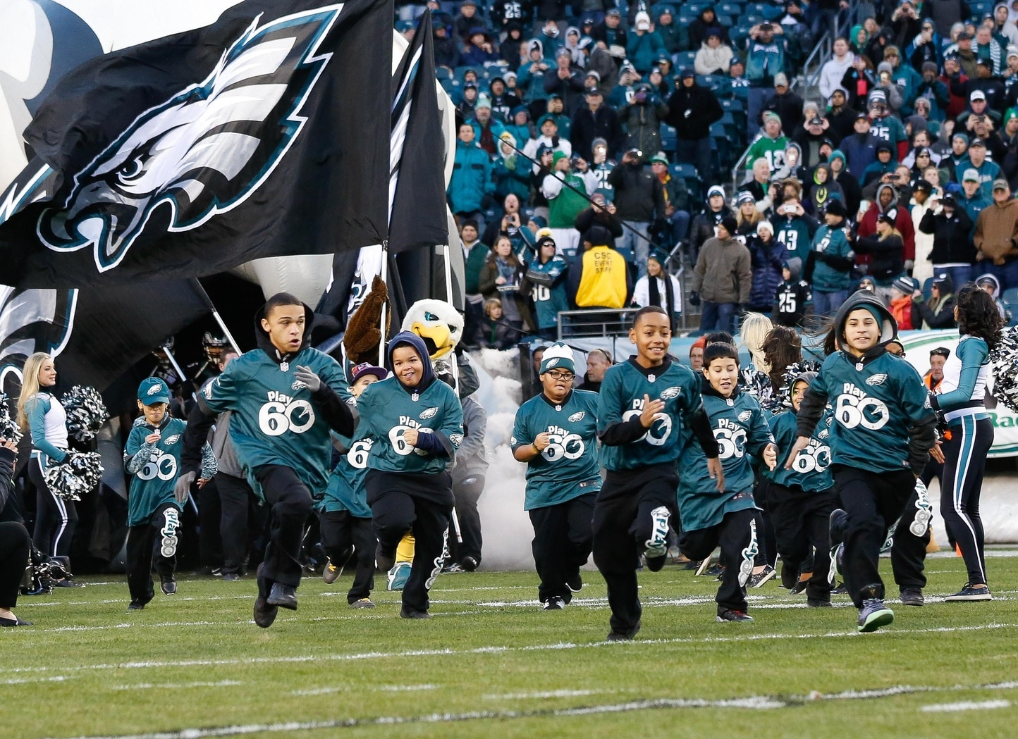 Dec 7, 2014; Philadelphia, PA, USA; Young fans lead the Philadelphia Eagles out of the tunnel to begin a game against the Seattle Seahawks at Lincoln Financial Field. The Seahawks defeated the Eagles 24-14. Mandatory Credit: Bill Streicher-USA TODAY Sports