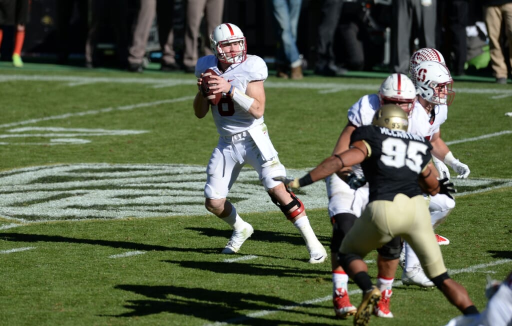 Kevin Hogan StanfordNov 7, 2015; Boulder, CO, USA; Stanford Cardinal quarterback Kevin Hogan (8) drops back to pass the football in the third quarter against the Colorado Buffaloes at Folsom Field. The Cardinals defeated the Buffaloes 42-10. Mandatory Credit: Ron Chenoy-USA TODAY Sports