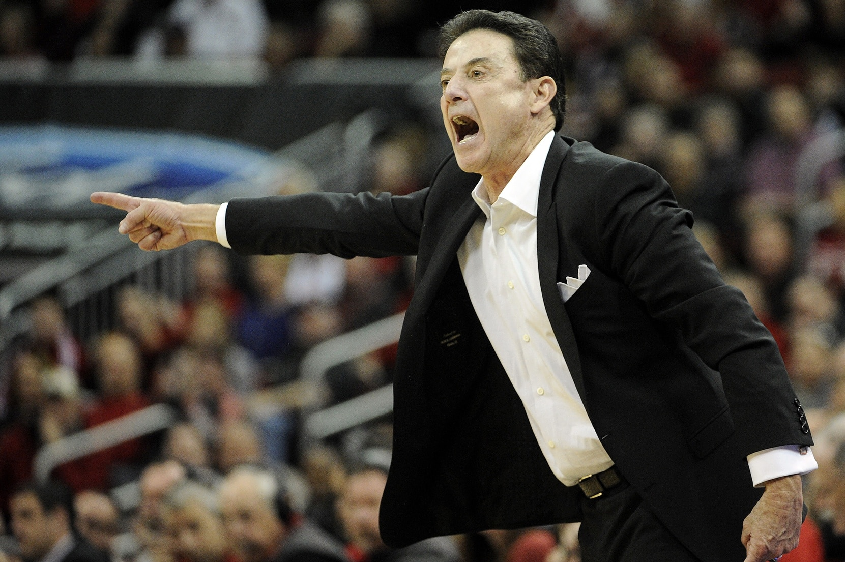 Louisville Cardinals head coach Rick Pitino is embroiled in one of the biggest scandals of college basketball in recent history