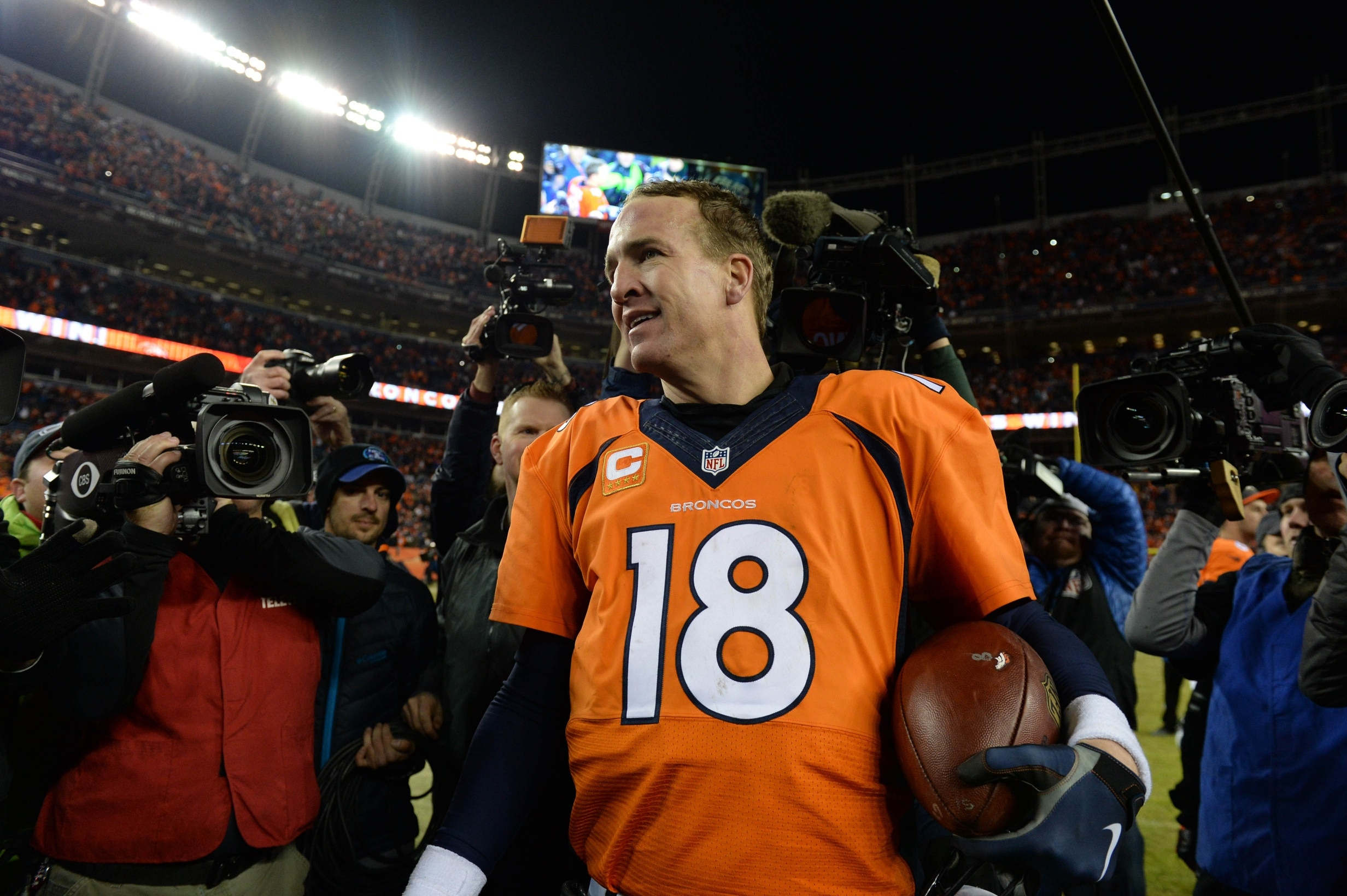 Jan 3, 2016; Denver, CO, USA; Denver Broncos quarterback Peyton Manning (18) celebrates winning following the game against the San Diego Chargers at Sports Authority Field at Mile High. The Broncos defeated the Chargers 27-20. Mandatory Credit: Ron Chenoy-USA TODAY Sports