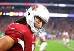 Jan 3, 2016; Glendale, AZ, USA; Arizona Cardinals wide receiver Larry Fitzgerald (11) reacts on the sidelines against the Seattle Seahawks at University of Phoenix Stadium. Mandatory Credit: Mark J. Rebilas-USA TODAY Sports