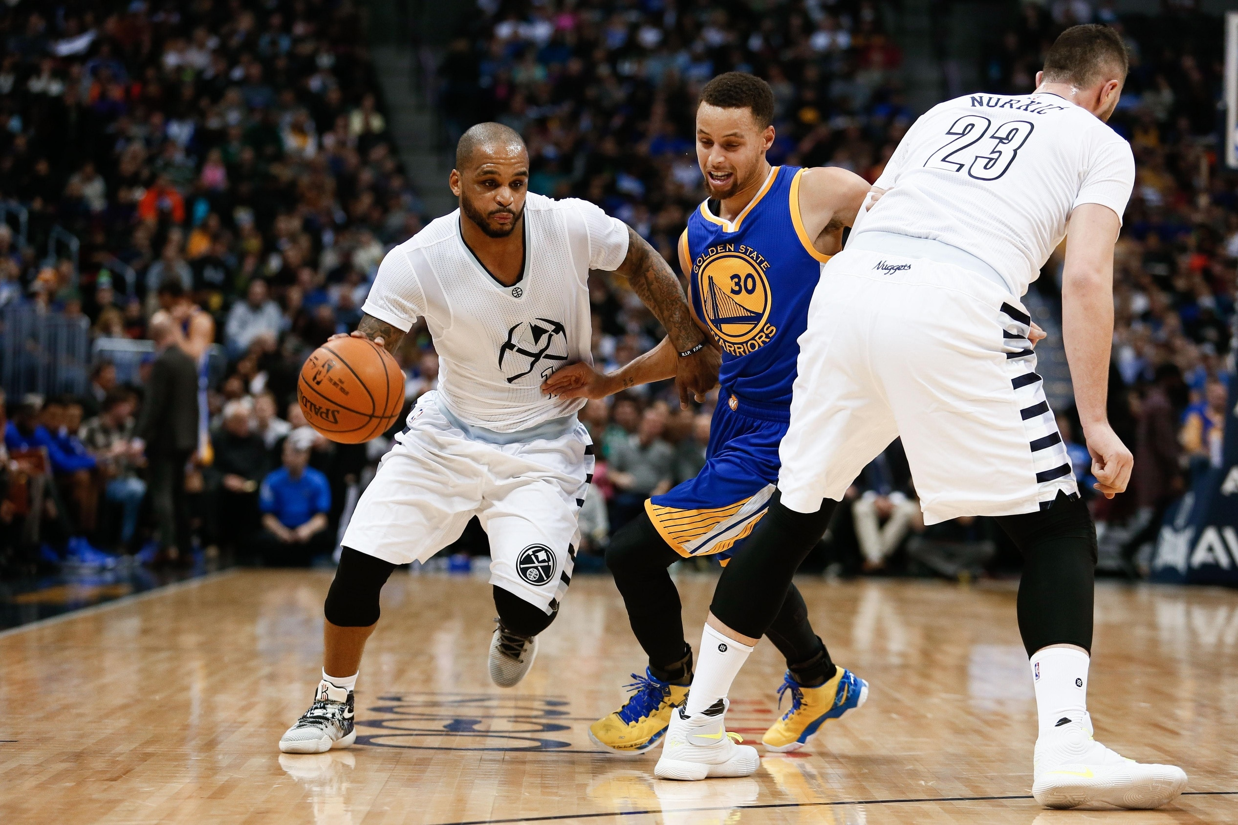 Jan 13, 2016; Denver, CO, USA; Golden State Warriors guard Stephen Curry (30) defends against Denver Nuggets guard Jameer Nelson (1) and center Jusuf Nurkic (23) in the first quarter at the Pepsi Center. Mandatory Credit: Isaiah J. Downing-USA TODAY Sports