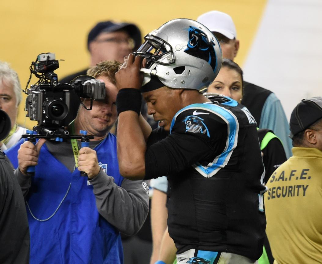 Feb 7, 2016; Santa Clara, CA, USA; Carolina Panthers quarterback Cam Newton (1) reacts as he takes off his helmet in the fourth quarter against the Denver Broncos in Super Bowl 50 at Levi's Stadium. Mandatory Credit: Robert Hanashiro-USA TODAY Sports