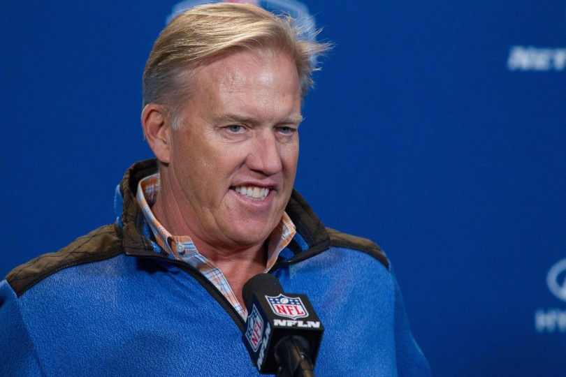 John Elway and the Broncos are looking to move up in the draft