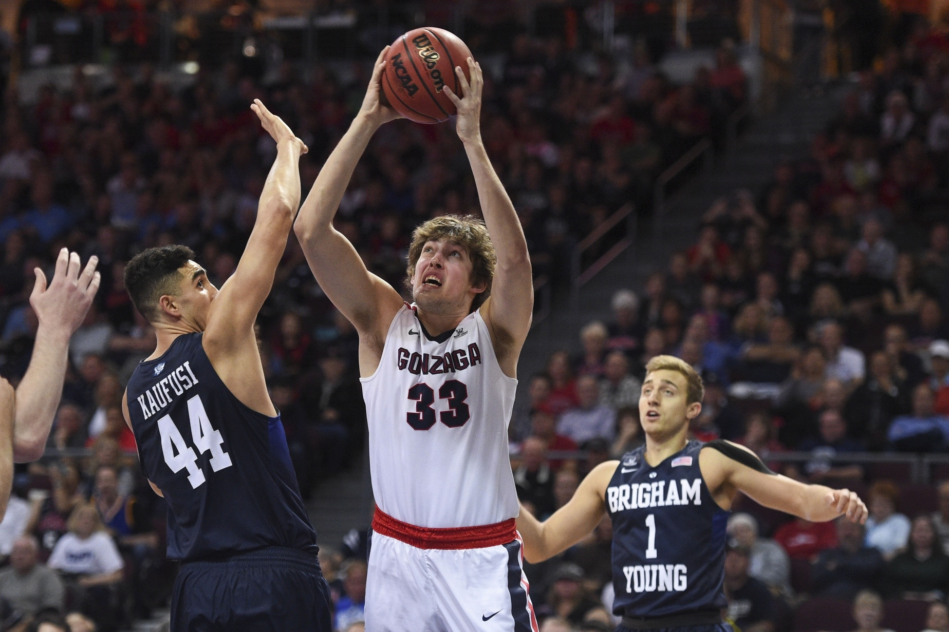 March 7, 2016; Las Vegas, NV, USA; Gonzaga Bulldogs forward Kyle Wiltjer (33) shoots the basketball against BYU Cougars center Corbin Kaufusi (44) and guard Chase Fischer (1) during the first half in the semifinals of the West Coast Conference tournament at Orleans Arena. Mandatory Credit: Kyle Terada-USA TODAY Sports