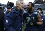 January 18, 2015; Seattle, WA, USA; Seattle Seahawks defensive end Michael Bennett (72) celebrates with head coach Pete Carroll after the 28-22 victory against the Green Bay Packers in the NFC Championship game at CenturyLink Field. Mandatory Credit: Joe Nicholson-USA TODAY Sports