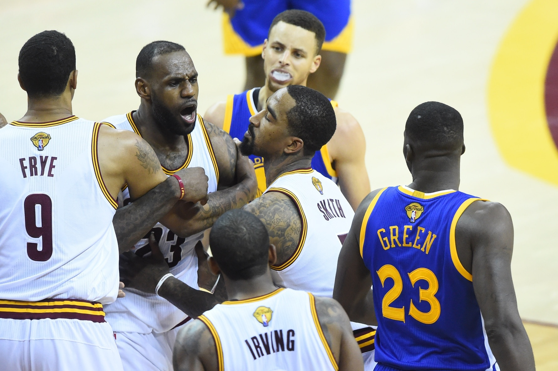 Jun 10, 2016; Cleveland, OH, USA; Cleveland Cavaliers forward LeBron James (23) exchanges words with Golden State Warriors forward Draymond Green (23) during the fourth quarter in game four of the NBA Finals at Quicken Loans Arena. The Warriors won 108-97. Mandatory Credit: David Richard-USA TODAY Sports