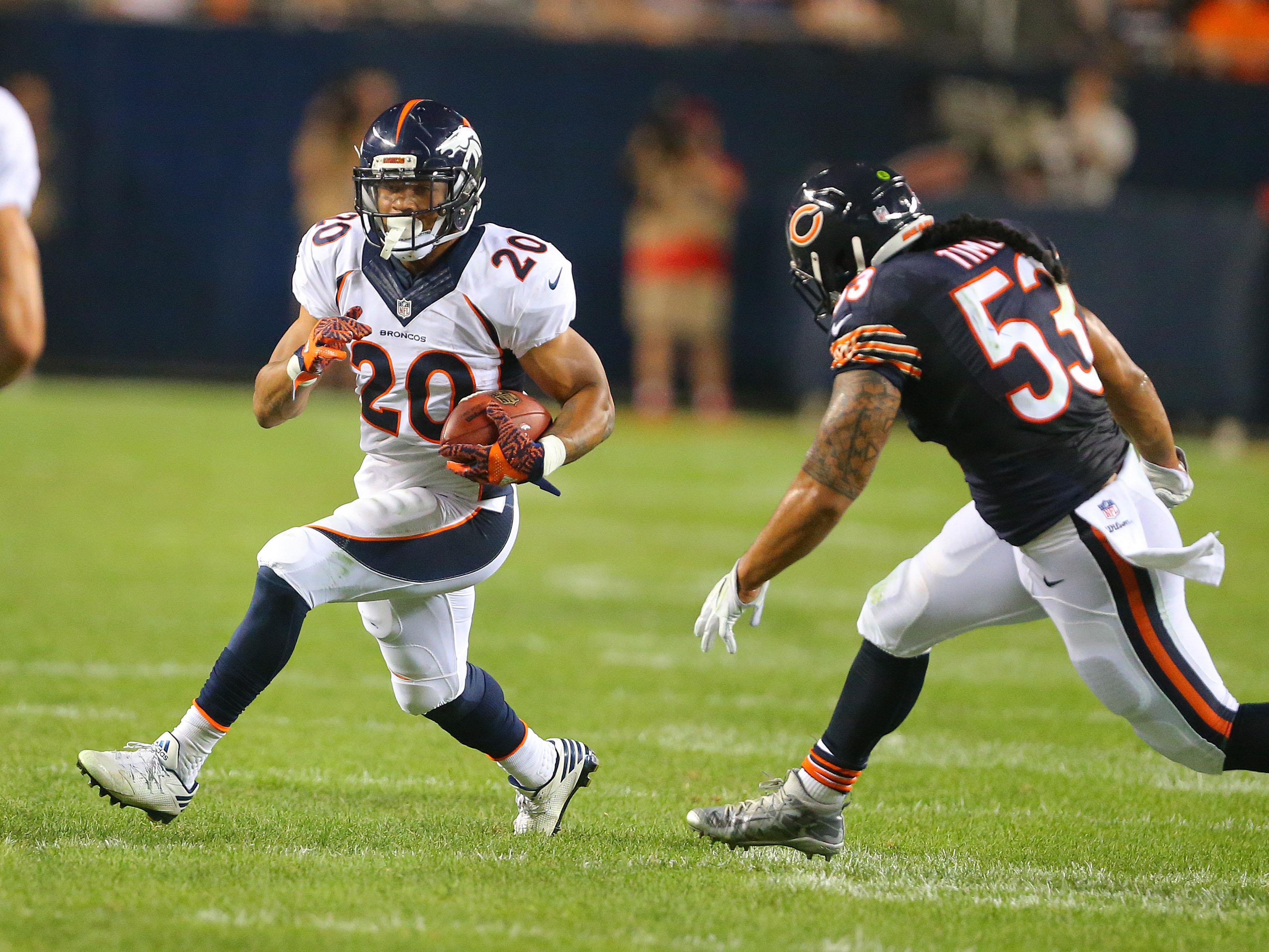 Aug 11, 2016; Chicago, IL, USA; Denver Broncos running back Devontae Booker (20) runs against Chicago Bears inside linebacker John Timu (53) during the second half at Soldier Field. Denver won 22-0. Mandatory Credit: Dennis Wierzbicki-USA TODAY Sports