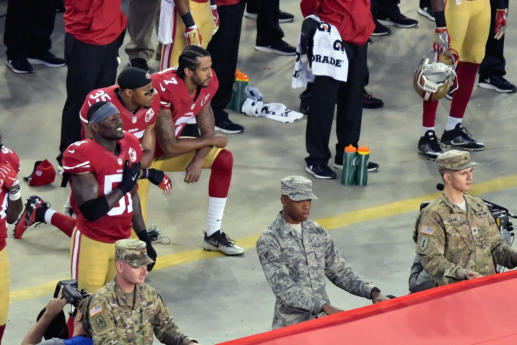 Eric Reid and Colin Kaepernick kneel during the anthem