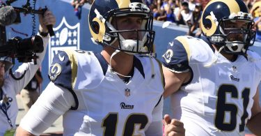 Rams quarterback Jared Goff leads the team on the field