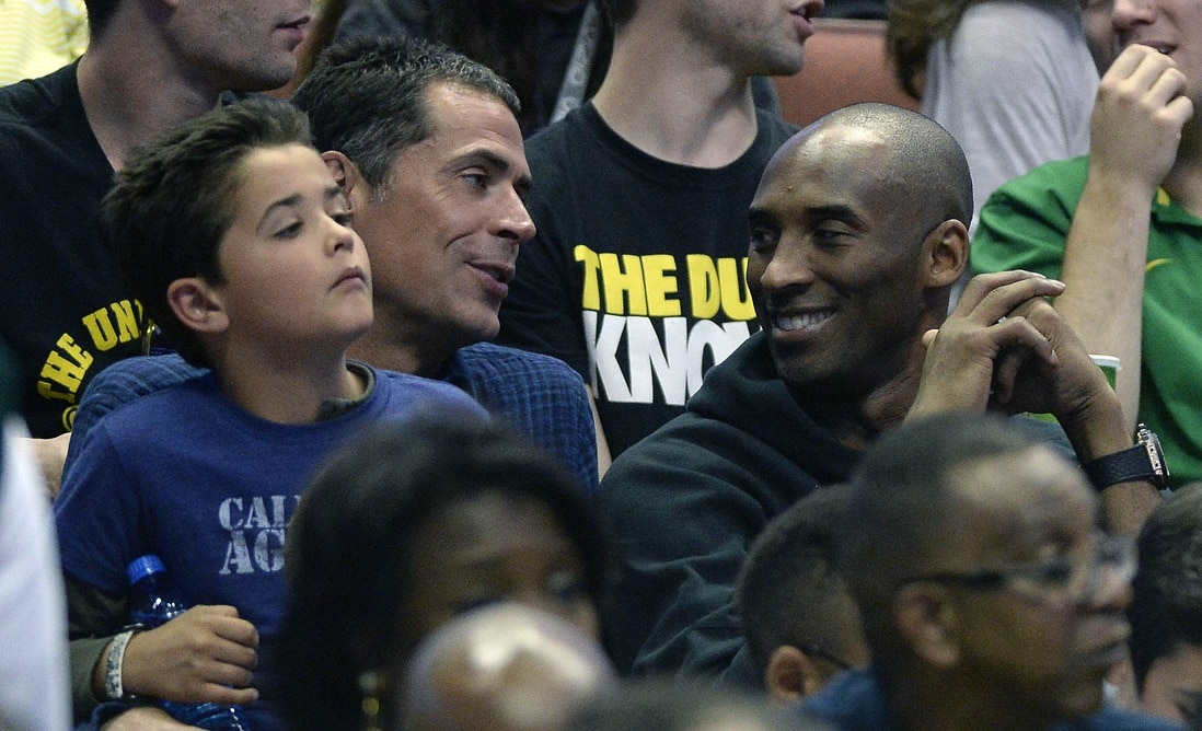 Caption: March 26, 2016; Anaheim, CA, USA; Los Angeles Lakers player Kobe Bryant with agent Rob Pelinka in attendance as the Oregon Ducks play against Oklahoma Sooners during the second half of the West regional final of the NCAA Tournament at Honda Center. Mandatory Credit: Richard Mackson-USA TODAY Sports