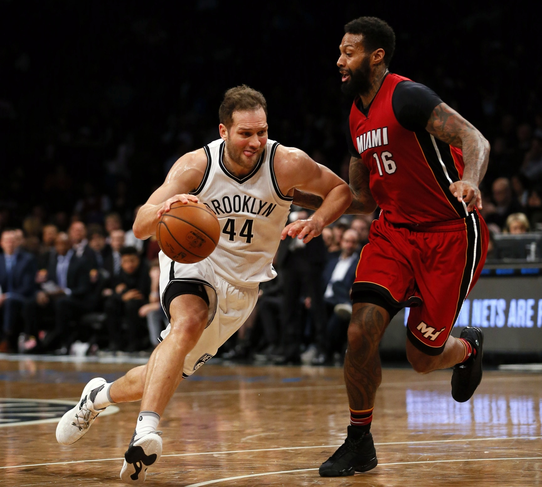 Caption: Jan 25, 2017; Brooklyn, NY, USA; Brooklyn Nets guard Bojan Bogdanovic (44) drives to the basket against Miami Heat forward James Johnson (16) during second half at Barclays Center. The Miami Heat defeated the Brooklyn Nets 109-106. Mandatory Credit: Noah K. Murray-USA TODAY Sports