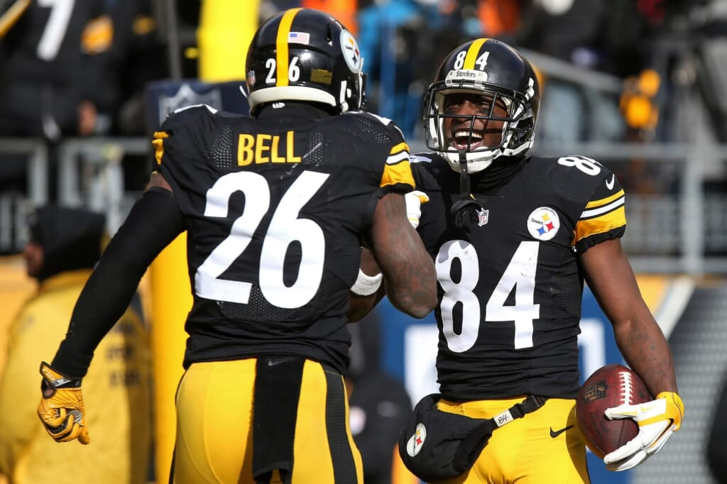NFL offenses, Jan 8, 2017; Pittsburgh, PA, USA; Pittsburgh Steelers wide receiver Antonio Brown (84) celebrates with Steelers running back Le'Veon Bell (26) after scoring a touchdown against the Miami Dolphins in the AFC Wild Card playoff football game at Heinz Field. Mandatory Credit: Geoff Burke-USA TODAY Sports