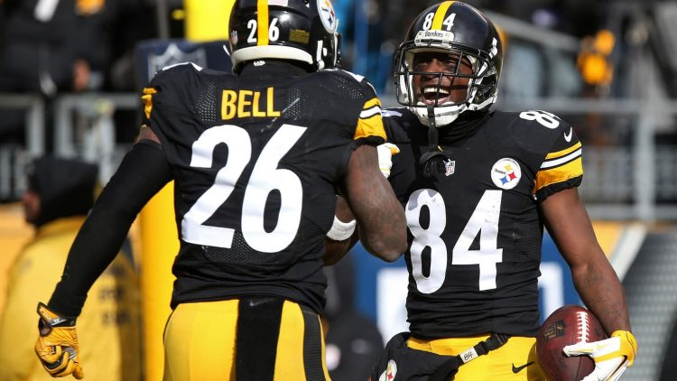Le'Veon Bell Antonio Brown, Jan 8, 2017; Pittsburgh, PA, USA; Pittsburgh Steelers wide receiver Antonio Brown (84) celebrates with Steelers running back Le'Veon Bell (26) after scoring a touchdown against the Miami Dolphins in the AFC Wild Card playoff football game at Heinz Field. Mandatory Credit: Geoff Burke-USA TODAY Sports