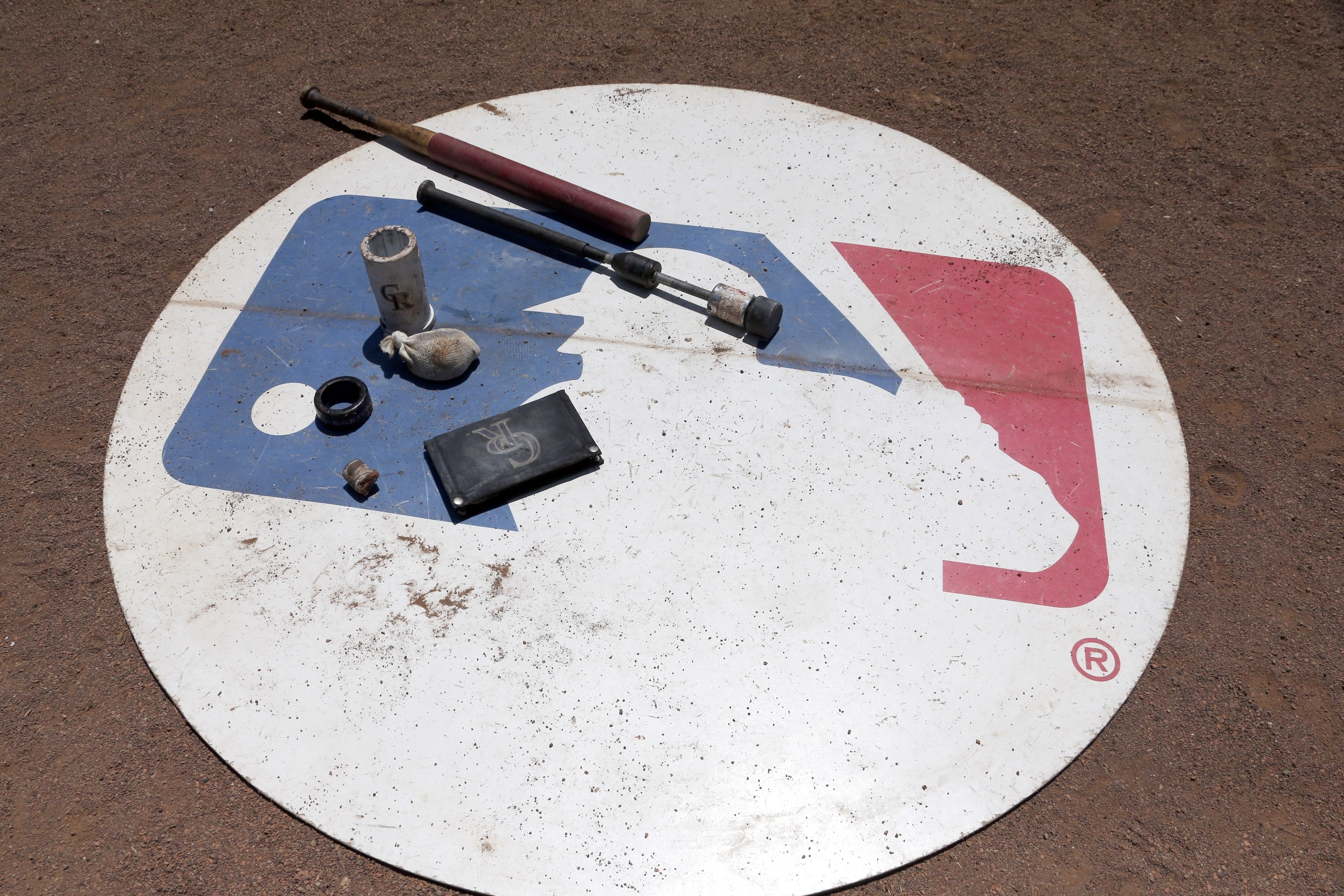 Aug 11, 2016; Arlington, TX, USA; A general view of the MLB logo with Colorado Rockies batting gear on it during the game against the Texas Rangers at Globe Life Park in Arlington. Colorado Rockies won 12-9. Mandatory Credit: Tim Heitman-USA TODAY Sports