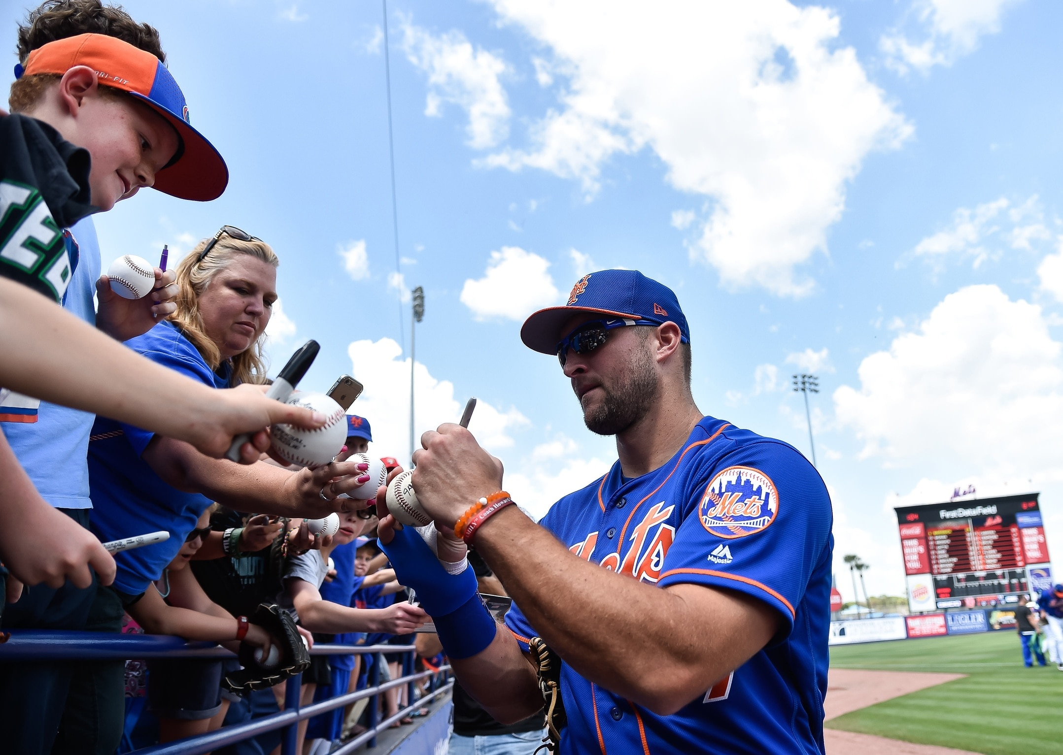 Mar 10, 2017; Port St. Lucie, FL, USA; New York Mets right fielder Tim Tebow (97) signs autographs before a spring training game against the Houston Astros at Tradition Field. Mandatory Credit: Steve Mitchell-USA TODAY Sports