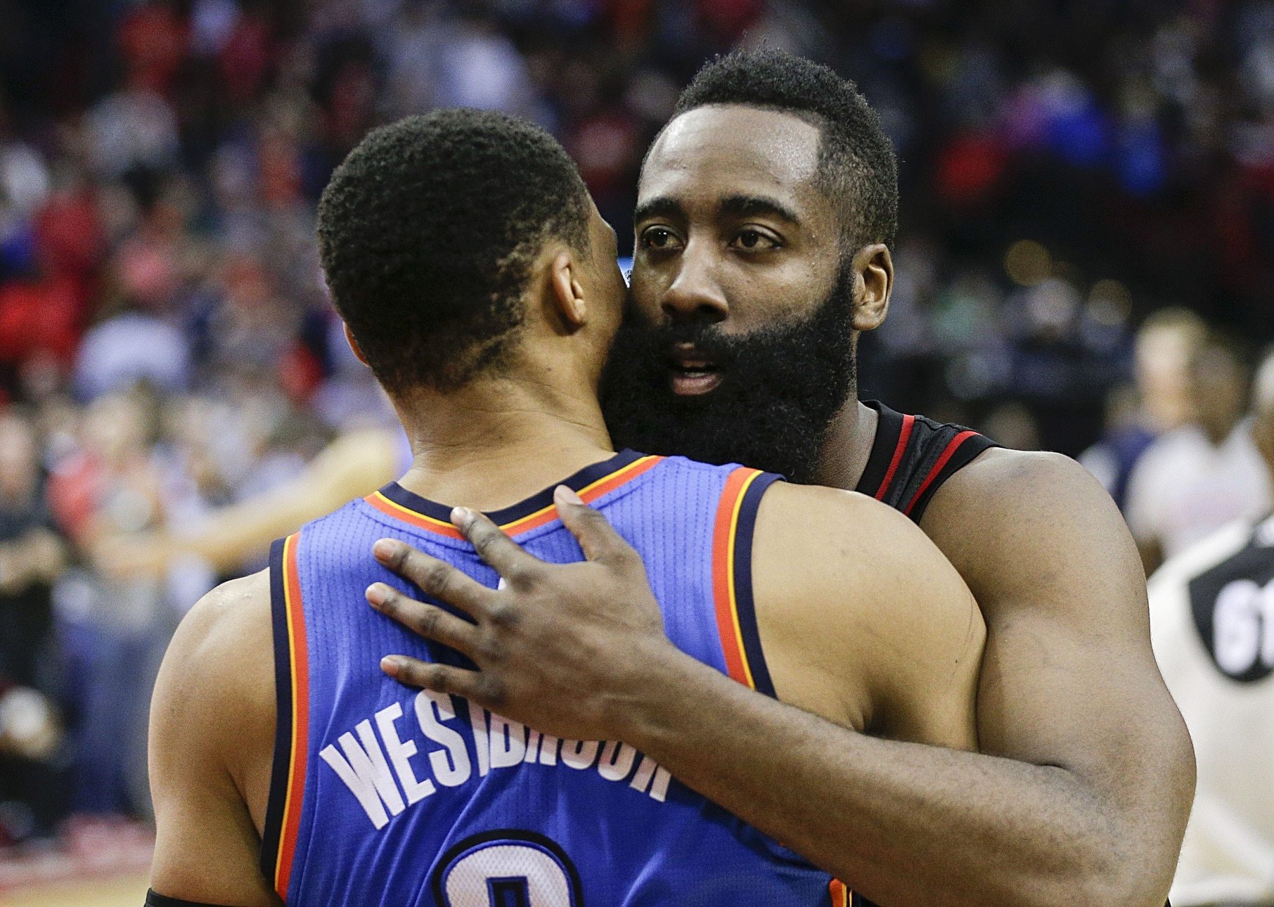 Jan 5, 2017; Houston, TX, USA; Houston Rockets guard James Harden (13) hugs Oklahoma City Thunder guard Russell Westbrook (0) after the Rockets defeated the City Thunder at Toyota Center. Houston Rockets won 118 to 116. Mandatory Credit: Thomas B. Shea-USA TODAY Sports