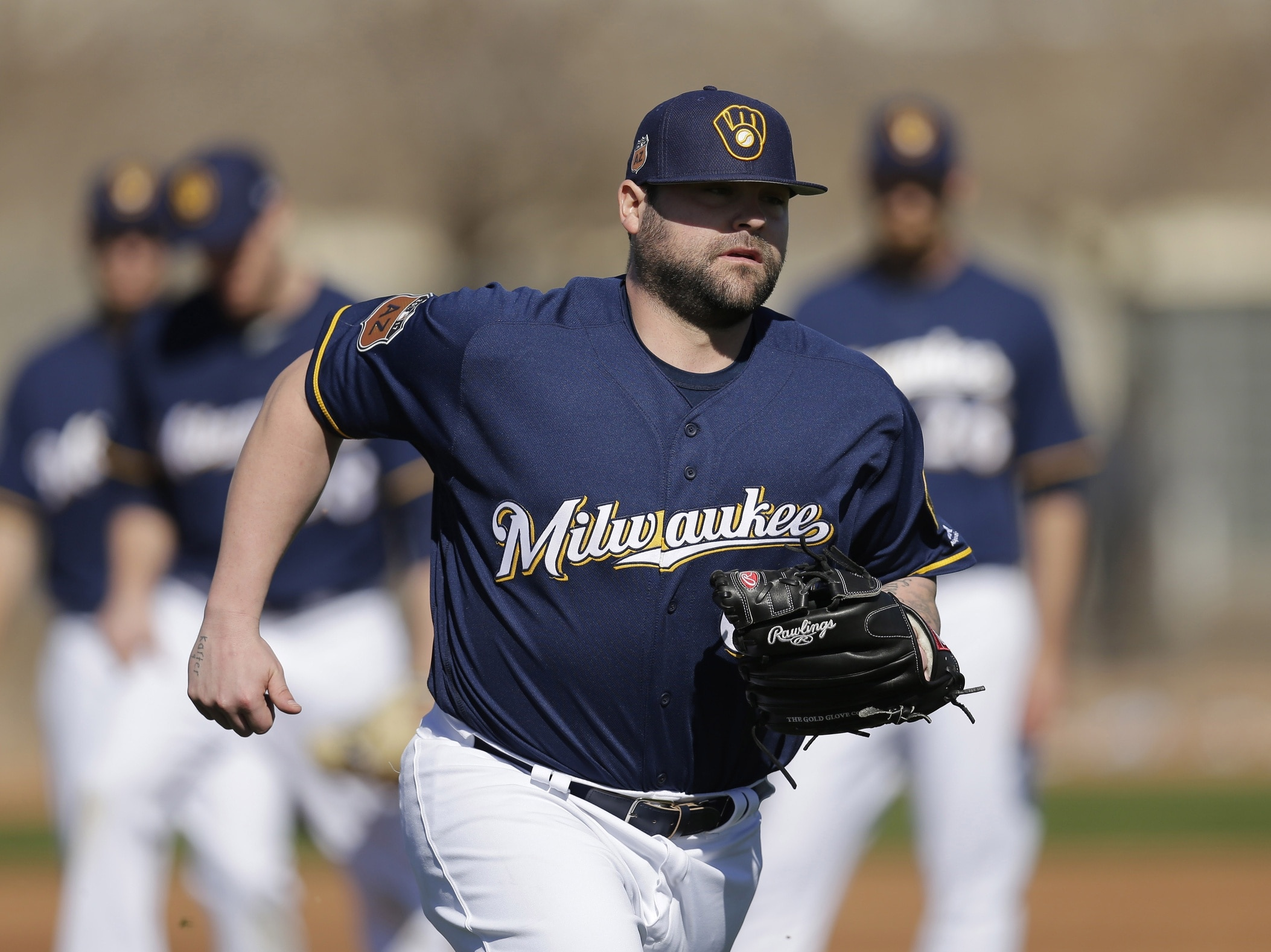 Feb 16, 2017; Maryvale, AZ, USA; Milwaukee Brewers relief pitcher Joba Chamberlain (62) covers first base during spring training camp drills at Maryvale Baseball Park. Mandatory Credit: Rick Scuteri-USA TODAY Sports