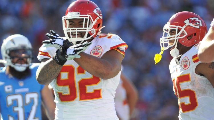 Nov 22, 2015; San Diego, CA, USA; Kansas City Chiefs nose tackle Dontari Poe (92) reacts after scoring a touchdown during the first half of the game against the San Diego Chargers at Qualcomm Stadium. Kansas City won 33-3. Mandatory Credit: Orlando Ramirez-USA TODAY Sports