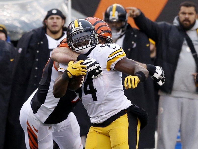Dec 18, 2016; Cincinnati, OH, USA; Pittsburgh Steelers inside linebacker Lawrence Timmons (94) runs against Cincinnati Bengals tackle Andrew Whitworth (77) after intercepting a pass during the second half at Paul Brown Stadium. The Steelers won 24-20. Mandatory Credit: David Kohl-USA TODAY Sports