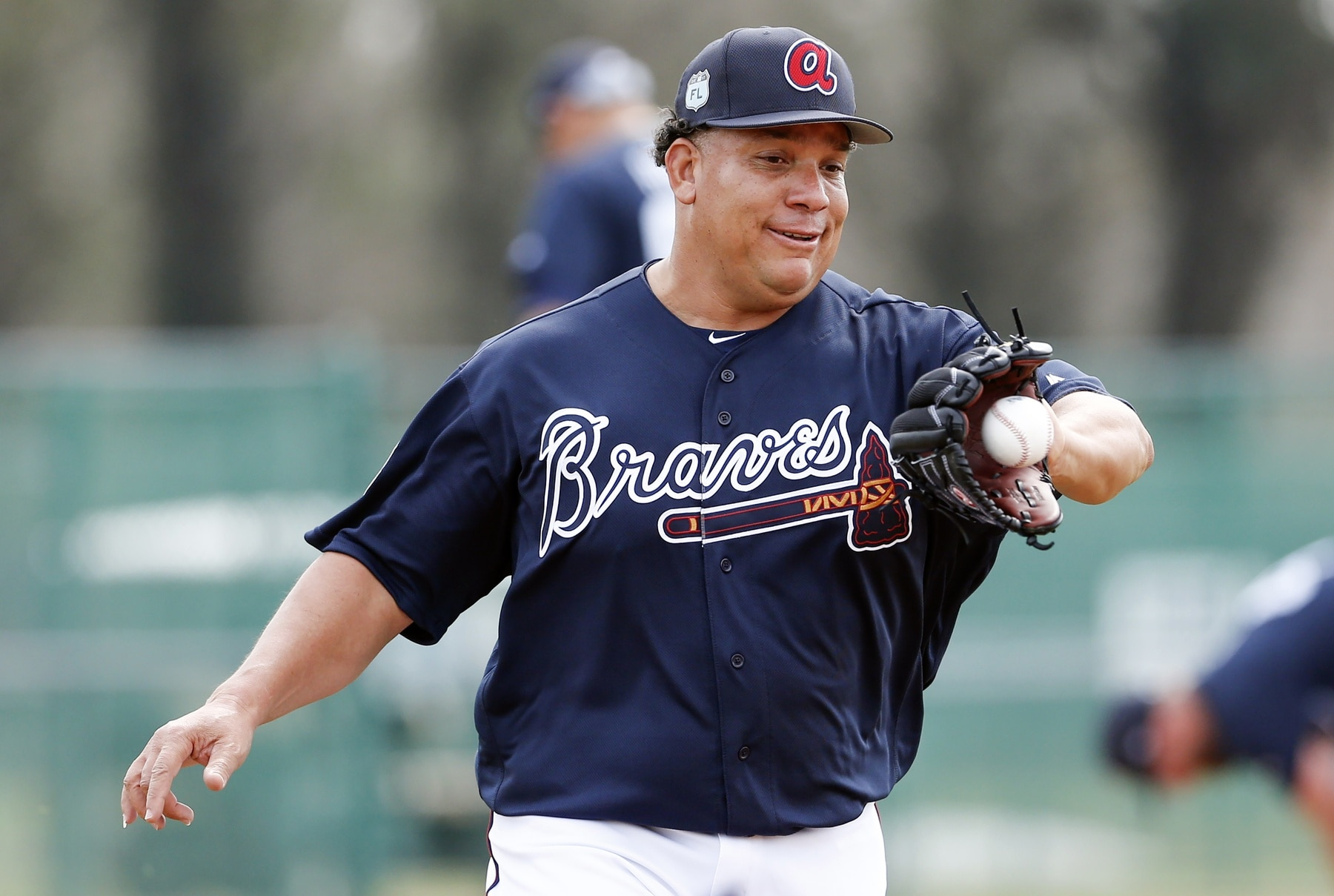 Feb 15, 2017; Lake Buena Vista, FL, USA; Atlanta Braves starting pitcher Bartolo Colon (40) catches a ball while covering first base during MLB spring training workouts at Champion Stadium. Mandatory Credit: Reinhold Matay-USA TODAY Sports