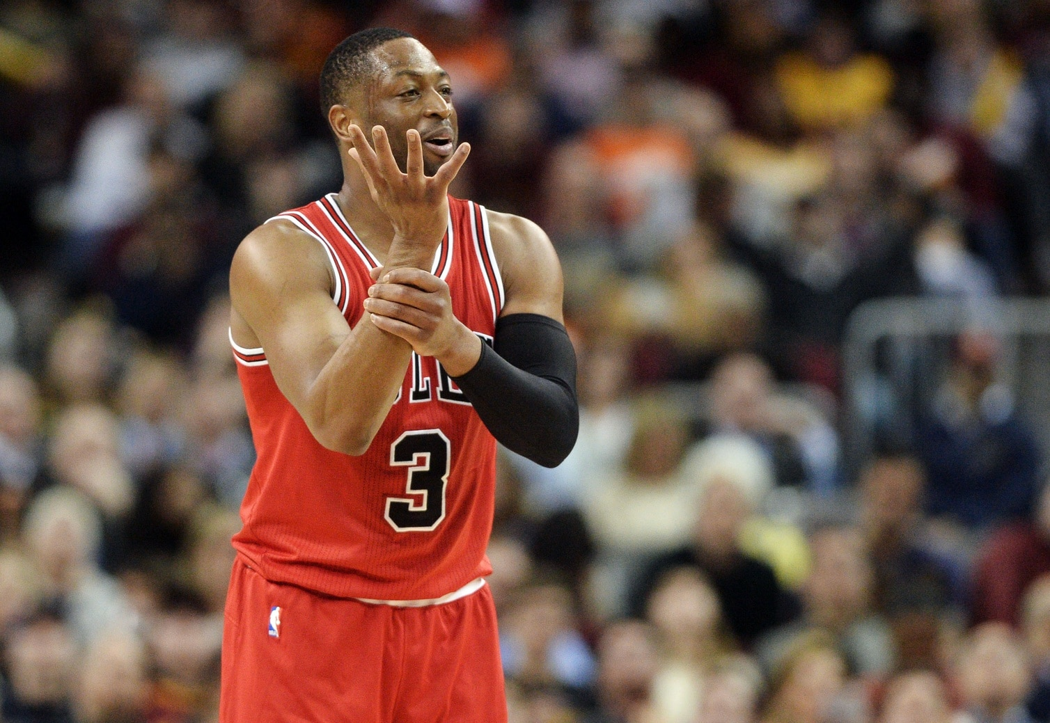 Feb 25, 2017; Cleveland, OH, USA; Chicago Bulls guard Dwyane Wade (3) reacts toward the Bulls bench after a play during the second half against the Cleveland Cavaliers at Quicken Loans Arena. The Bulls won 117-99. Mandatory Credit: Ken Blaze-USA TODAY Sports