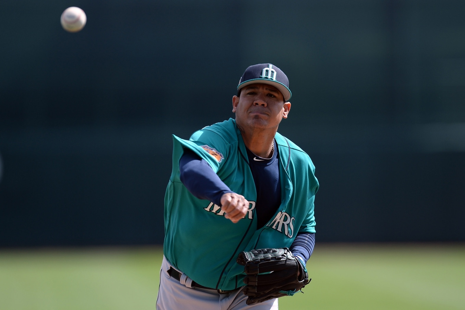 Feb 28, 2017; Phoenix, AZ, USA; Seattle Mariners starting pitcher Felix Hernandez (34) pitches in the first inning against the Chicago White Sox at Camelback Ranch. Mandatory Credit: