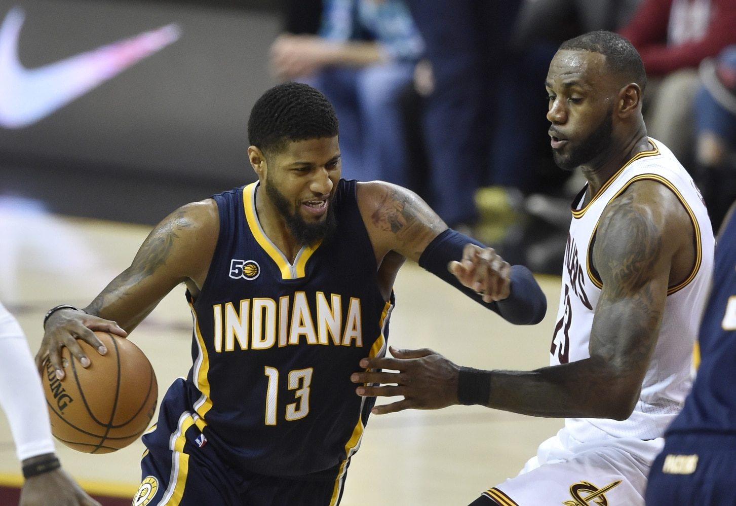 Caption: Apr 2, 2017; Cleveland, OH, USA; Indiana Pacers forward Paul George (13) drives against Cleveland Cavaliers forward LeBron James (23) in the second quarter at Quicken Loans Arena. Mandatory Credit: David Richard-USA TODAY Sports