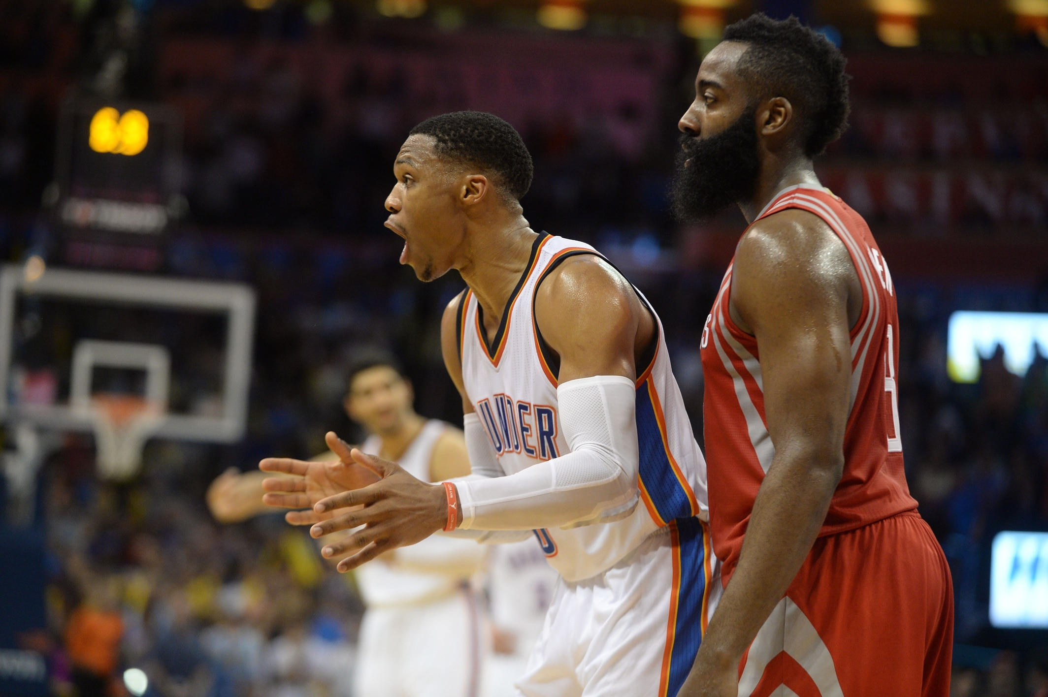 Caption: Nov 16, 2016; Oklahoma City, OK, USA; Oklahoma City Thunder guard Russell Westbrook (0) and Houston Rockets guard James Harden (13) react after a play against the Houston Rockets during the fourth quarter at Chesapeake Energy Arena. Mandatory Credit: Mark D. Smith-USA TODAY Sports