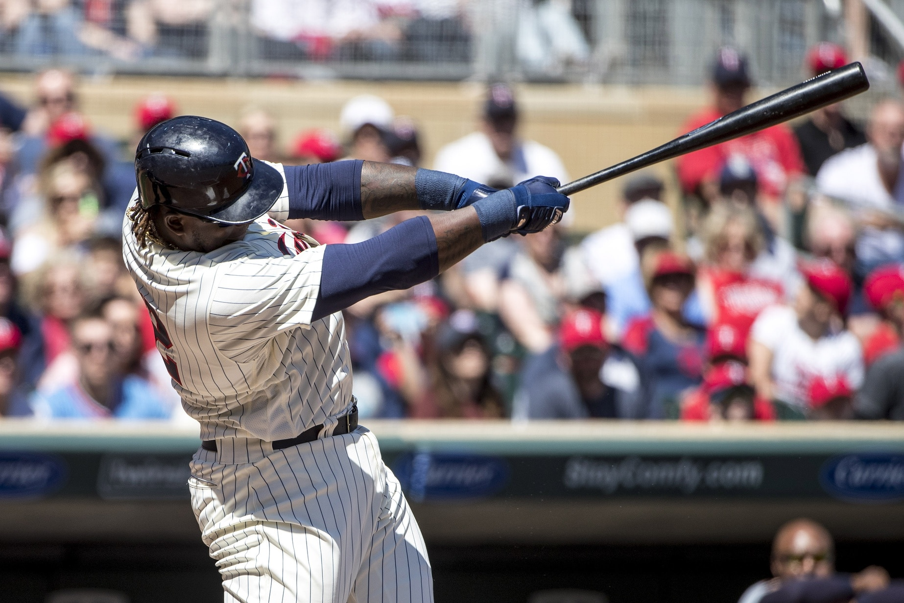 Apr 22, 2017; Minneapolis, MN, USA; Minnesota Twins first baseman Miguel Sano (22) hits a double in the first inning against the Detroit Tigers at Target Field. Mandatory Credit: Jesse Johnson-USA TODAY Sports