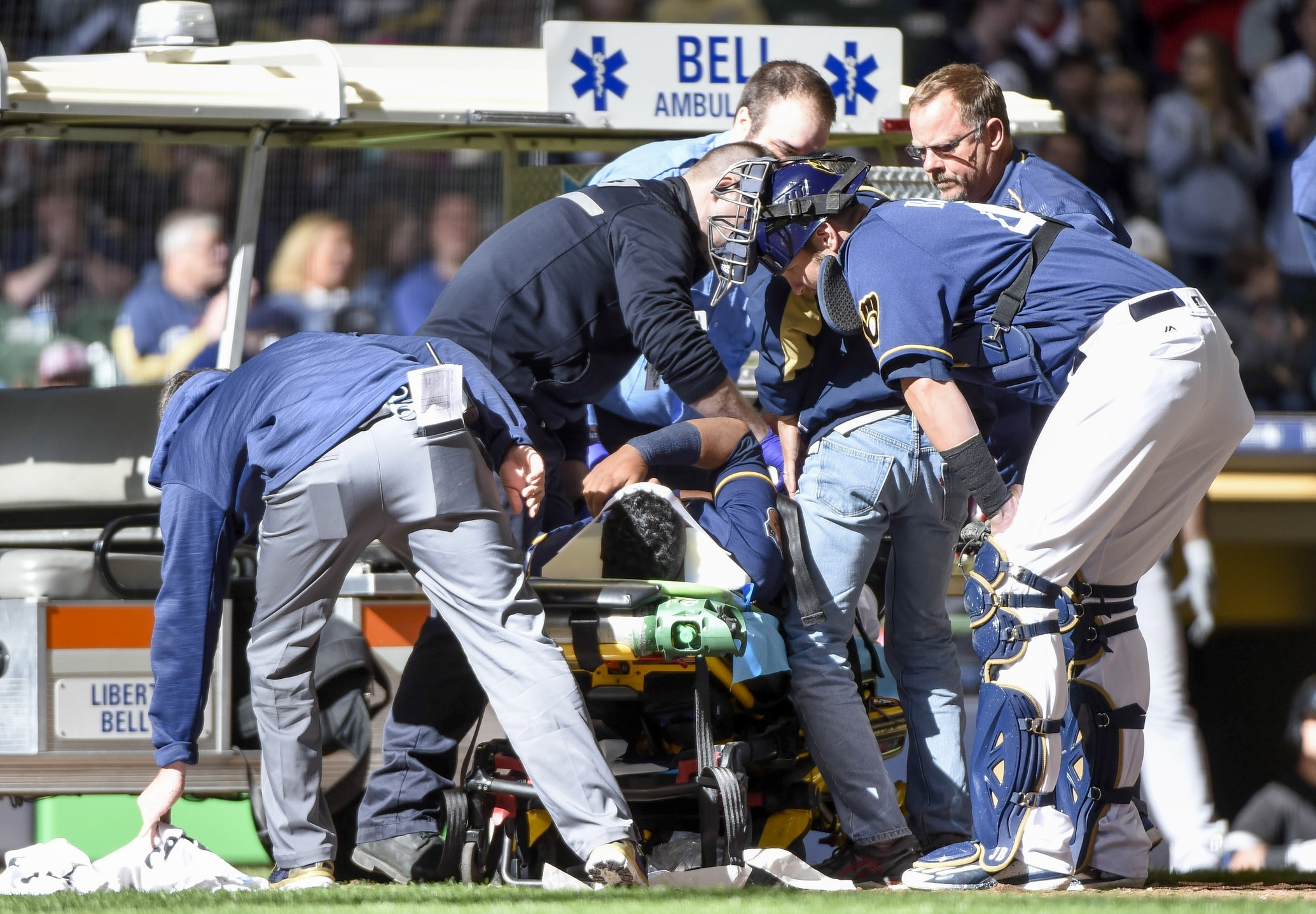 Apr 1, 2017; Milwaukee, WI, USA; Milwaukee Brewers catcher Jett Bandy (47) checks on Rene Garcia after Garcia was injured in the ninth inning during the game against the Chicago White Sox and had to be carted off the field at Miller Park. Mandatory Credit: Benny Sieu-USA TODAY Sports