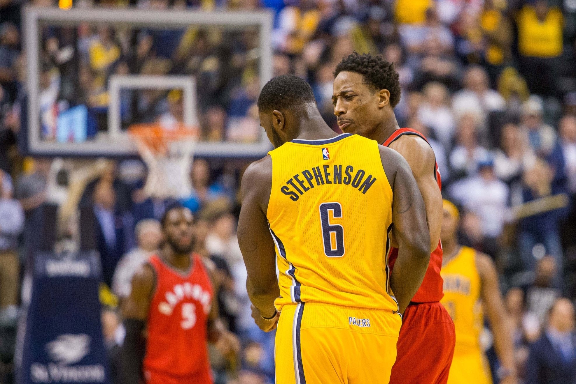 Caption: Apr 4, 2017; Indianapolis, IN, USA; Toronto Raptors guard DeMar DeRozan (10) gets into an altercation with Indiana Pacers guard Lance Stephenson (6) in the second half of the game at Bankers Life Fieldhouse. The Pacers beat the Raptors 108-90. Mandatory Credit: Trevor Ruszkowski-USA TODAY Sports