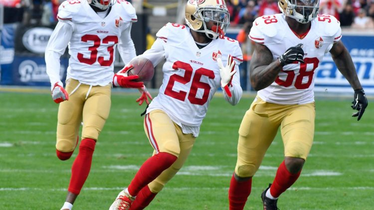 Dec 24, 2016; Los Angeles, CA, USA; San Francisco 49ers cornerback Tramaine Brock (center) runs upfield with a first quarter interception followed by cornerback Rashard Robinson (33) and outside linebacker Eli Harold (58) on a pass intended for Los Angeles Rams wide receiver Tavon Austin (not pictured) at Los Angeles Memorial Coliseum. Mandatory Credit: Robert Hanashiro-USA TODAY Sports