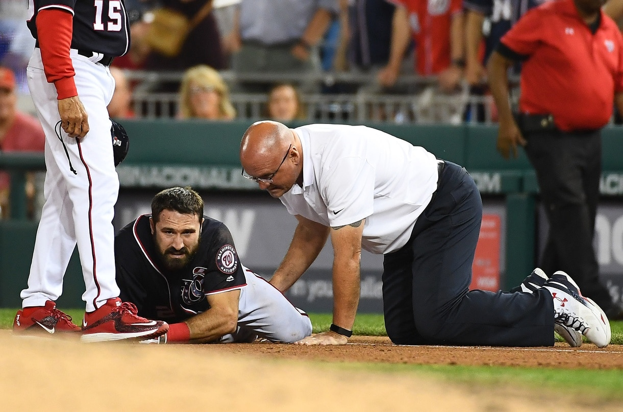 pr 28, 2017; Washington, DC, USA; Washington Nationals center fielder Adam Eaton (2) is looked at by a trainer after suffering an apparent leg injury during the ninth inning against the New York Mets at Nationals Park. Mandatory Credit: Brad Mills-USA TODAY Sports