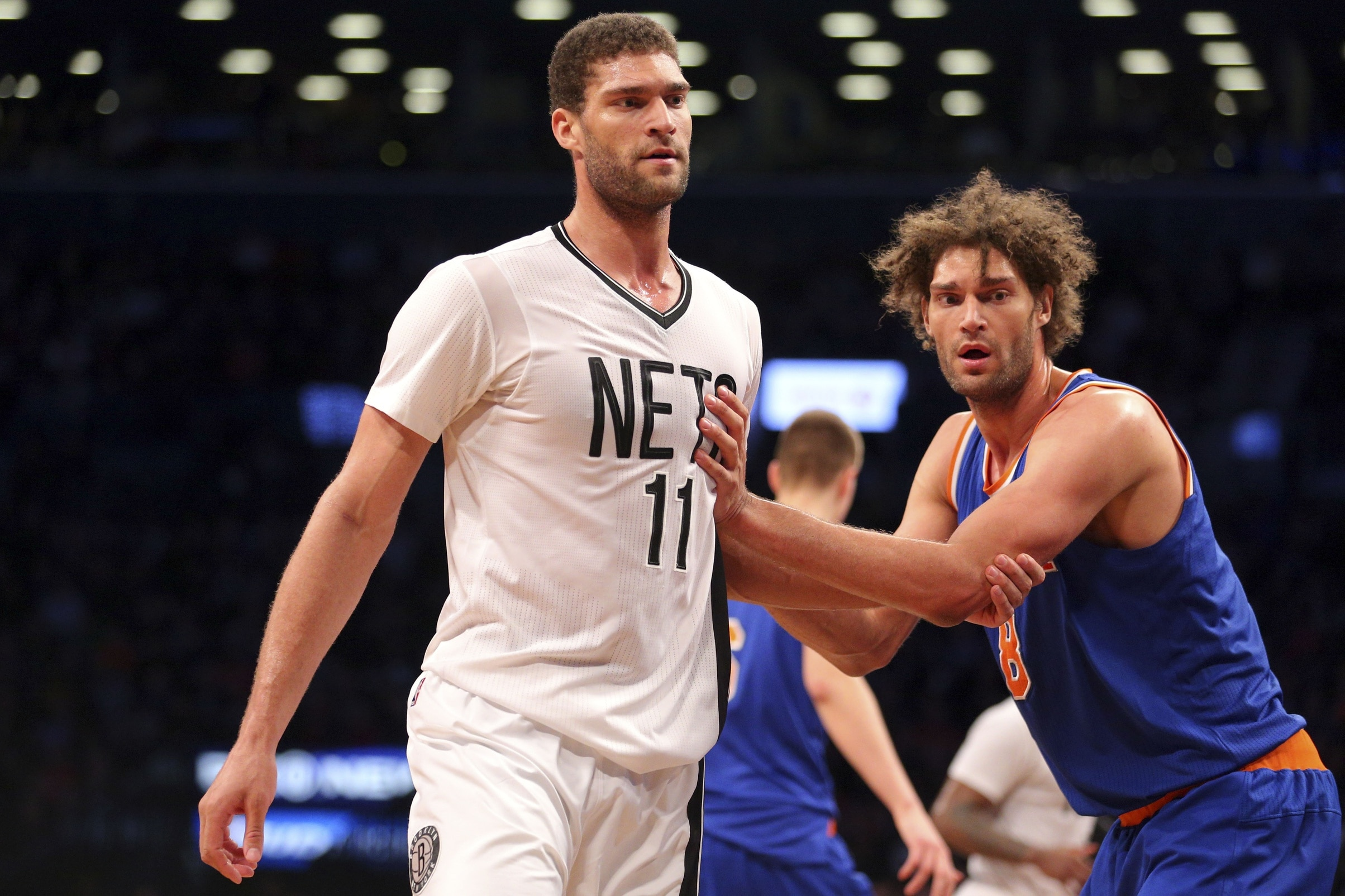 Feb 19, 2016; Brooklyn, NY, USA; New York Knicks center Robin Lopez (8) guards his brother Brooklyn Nets center Brook Lopez (11) during the fourth quarter at Barclays Center. The Nets defeated the Knicks 109-98. Mandatory Credit: Brad Penner-USA TODAY Sports