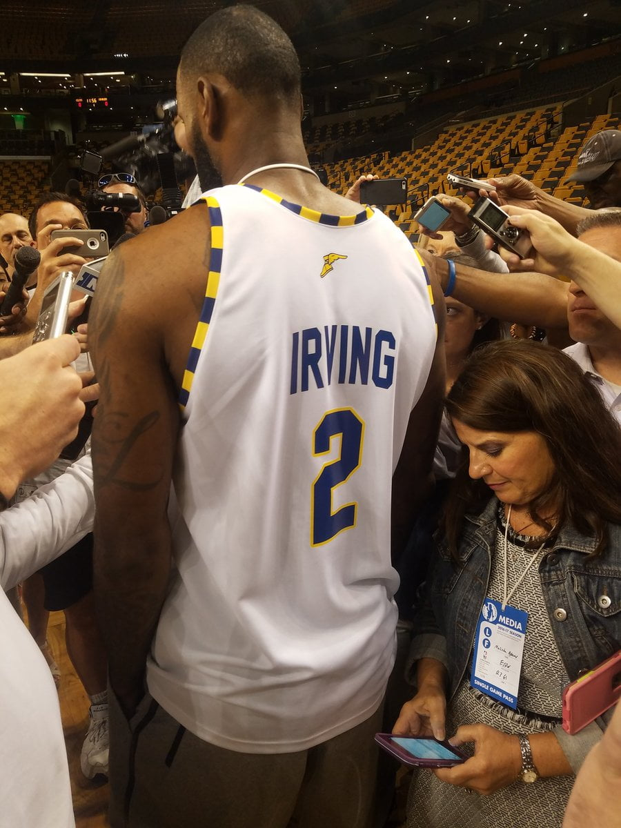 bcb359686c87 LeBron James arrives to practice wearing Kyrie Irving  Goodyear  jersey