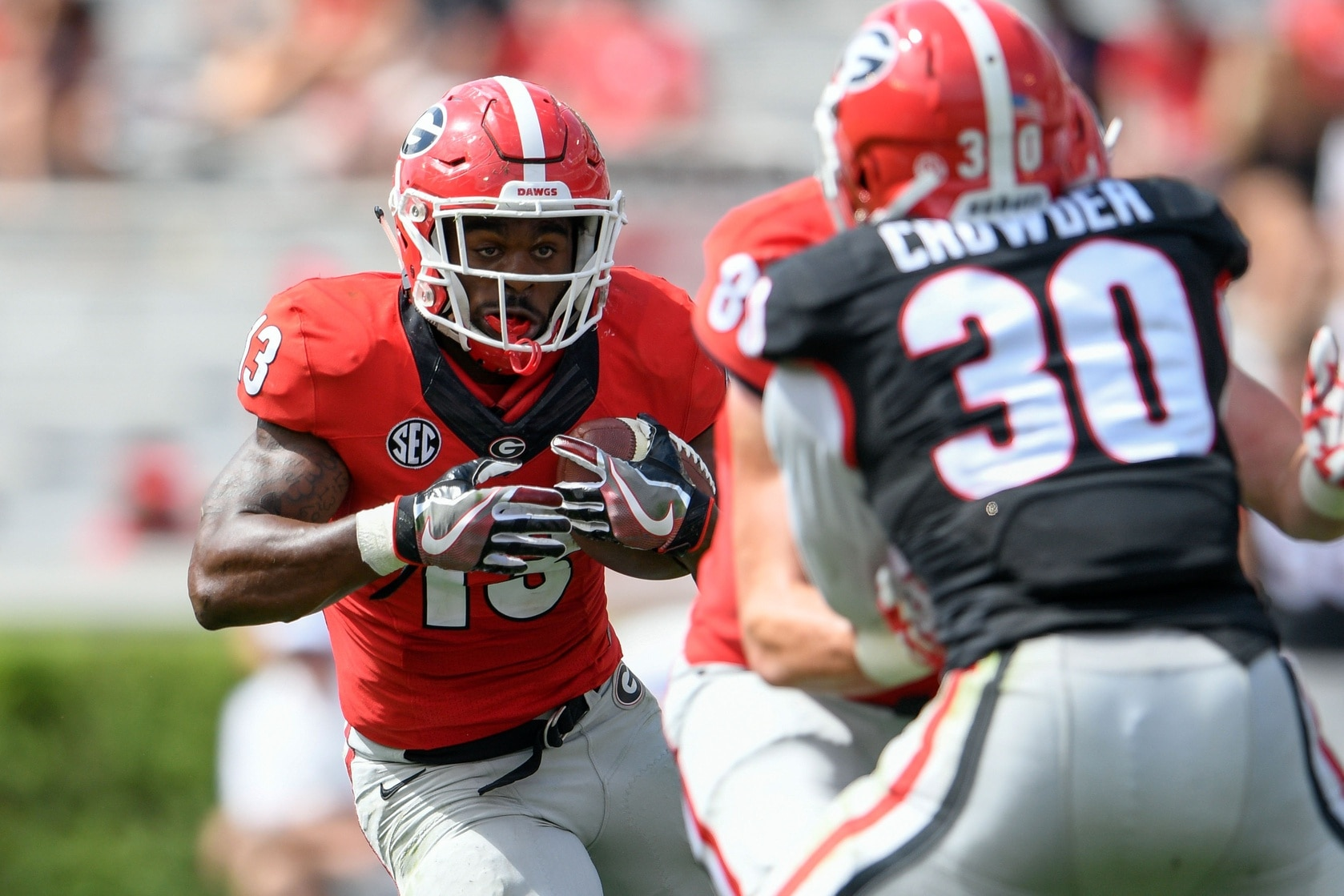 Apr 22, 2017; Athens, GA, USA; Georgia Bulldogs red team running back Elijah Holyfield (13) runs against black team linebacker Tae Crowder (30) during the second half during the Georgia Spring Game at Sanford Stadium. Red defeated Black 25-22. Mandatory Credit: Dale Zanine-USA TODAY Sports