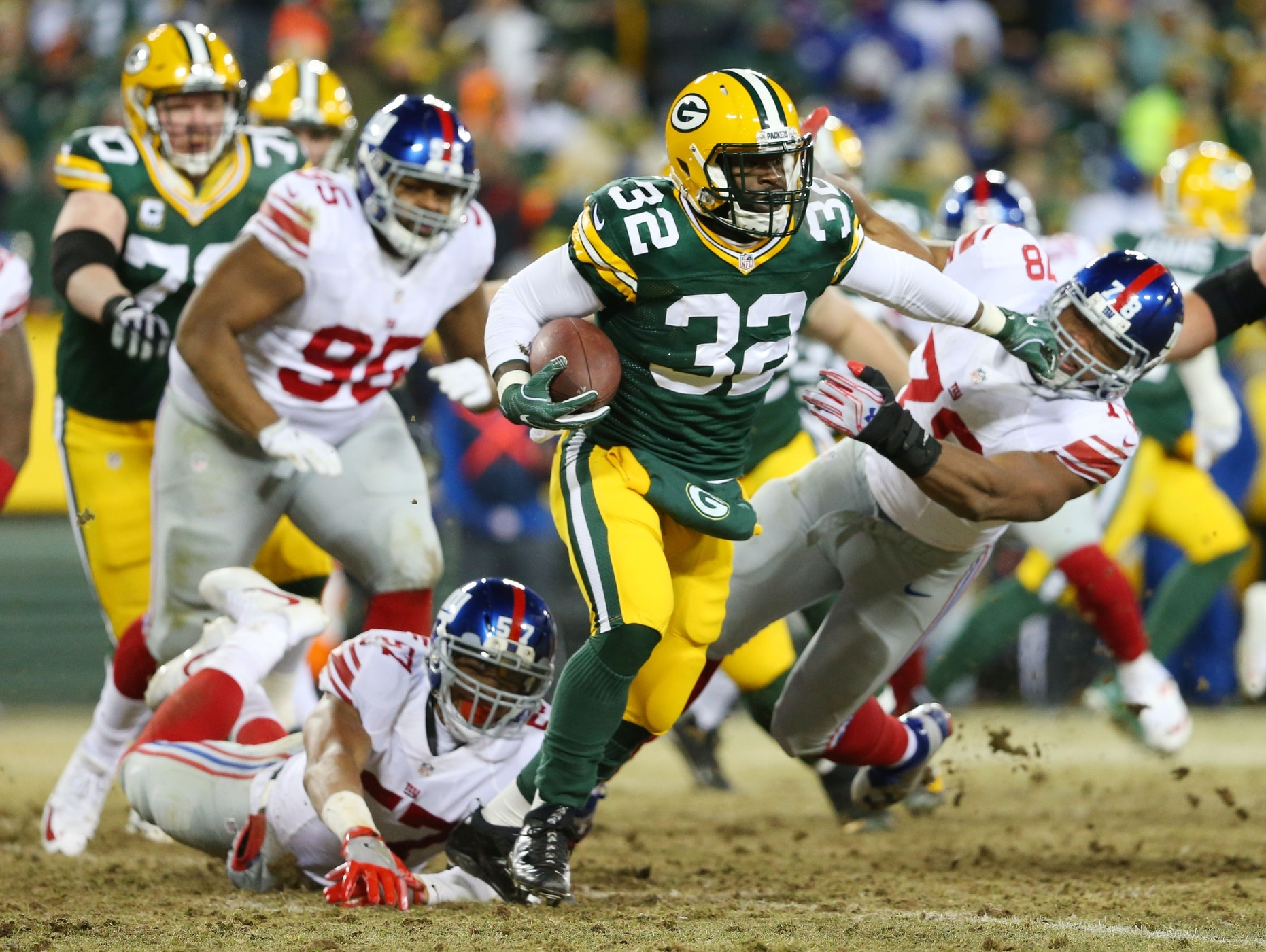 Jan 8, 2017; Green Bay, WI, USA; Green Bay Packers running back Christine Michael (32) stiff arms New York Giants defensive end Romeo Okwara (78) during the third quarter in the NFC Wild Card playoff football game at Lambea