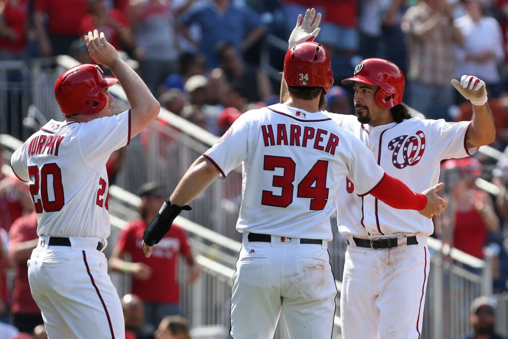 Caption: Apr 30, 2017; Washington, DC, USA; Washington Nationals third baseman Anthony Rendon (6) celebrates with Nationals second baseman Daniel Murphy (20) and Nationals right fielder Bryce Harper (34) after hitting a three-run home run against the New York Mets in the fourth inning at Nationals Park. Mandatory Credit: Geoff Burke-USA TODAY Sports