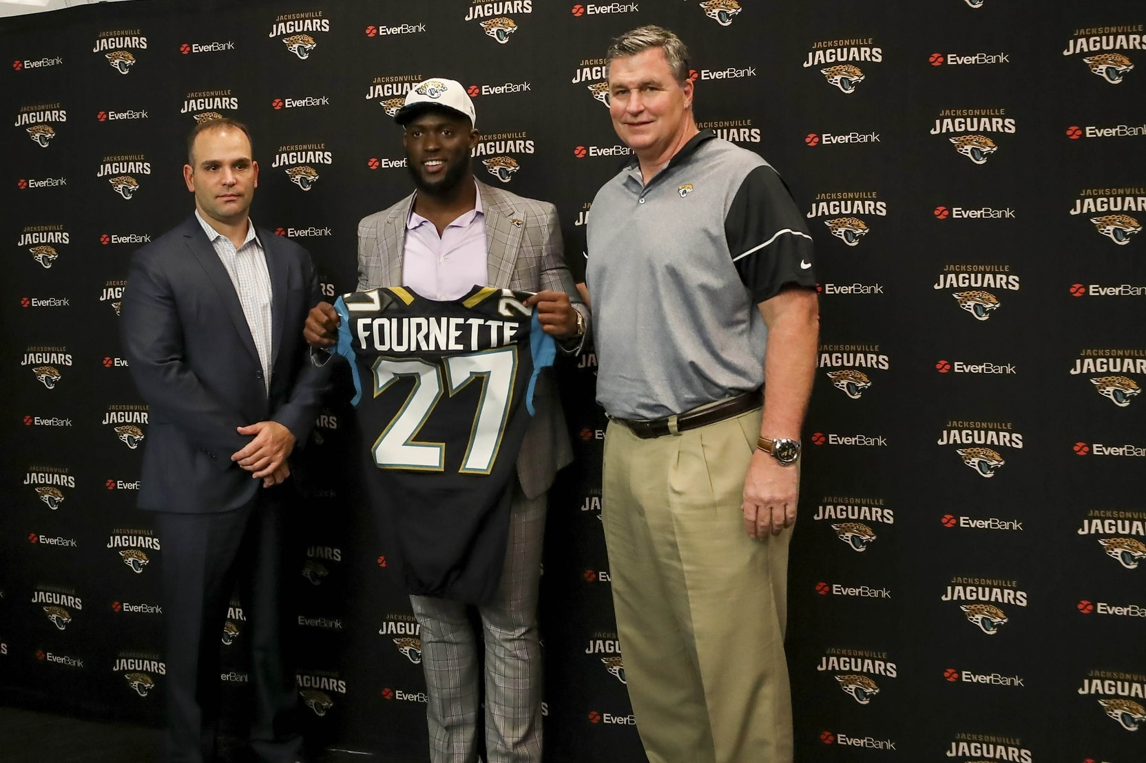 Apr 28, 2017; Jacksonville, FL, USA; Jacksonville Jaguars general manager Dave Caldwell (left), running back Leonard Fournette (center) and head coach Doug Marrone (right) pose for a picture during a press conference at EverBank Field. Leonard Fournette was the 2017 first round pick of the Jacksonville Jaguars. Mandatory Credit: Logan Bowles-USA TODAY Sports