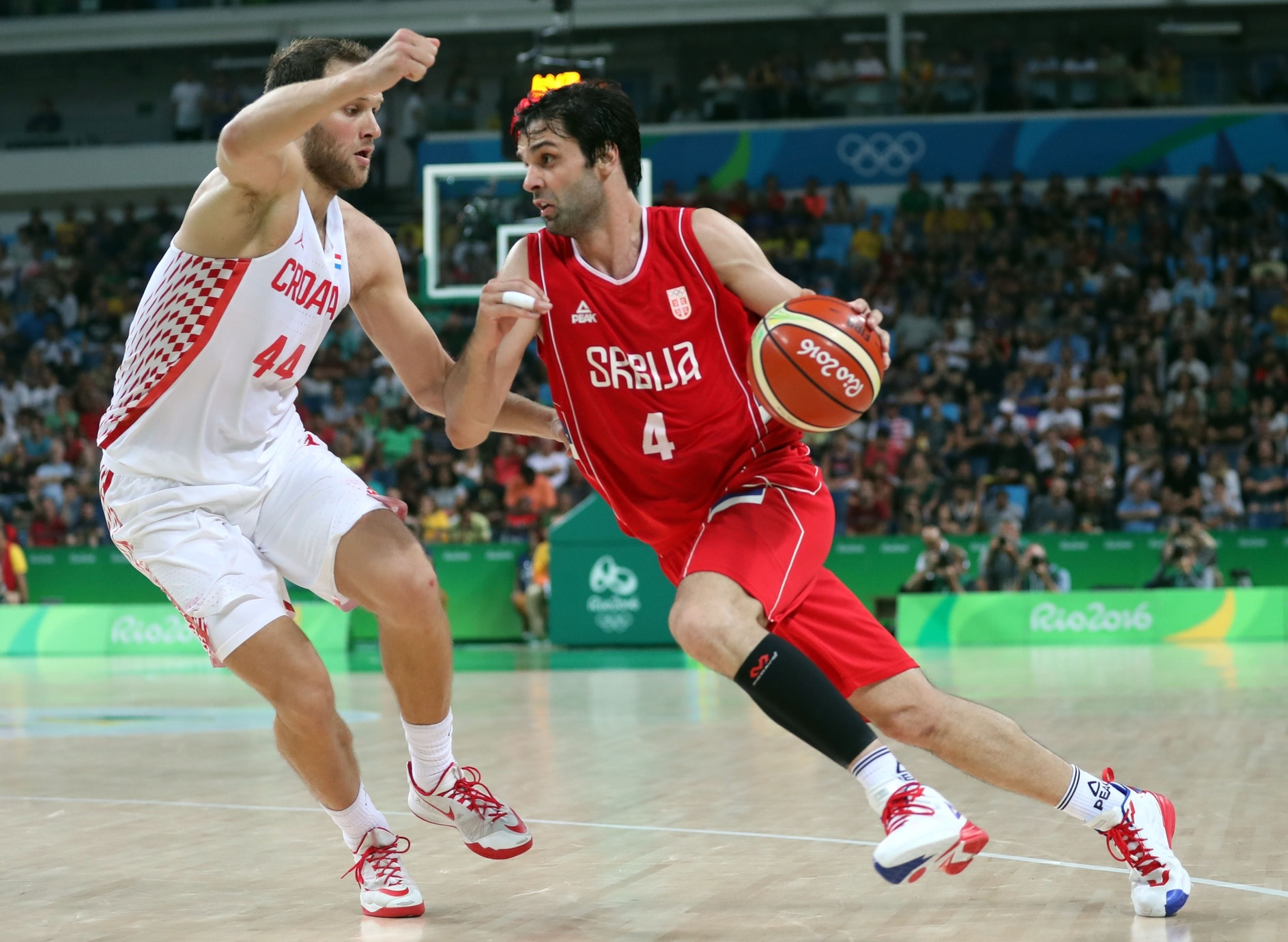Aug 17, 2016; Rio de Janeiro, Brazil; Serbia point guard Milos Teodosic (4) drives to the basket against Croatia shooting guard Bojan Bogdanovic (44) during the men's basketball quarterfinals in the Rio 2016 Summer Olympic Games at Carioca Arena 1. Mandatory Credit: Jeff Swinger-USA TODAY Sports