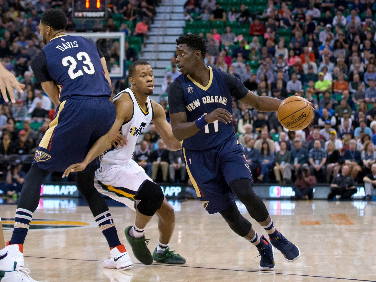 Caption: Mar 27, 2017; Salt Lake City, UT, USA; Utah Jazz guard Rodney Hood (5) fights around the screen of New Orleans Pelicans forward Anthony Davis (23) while defending guard Jrue Holiday (11) during the first quarter at Vivint Smart Home Arena. Mandatory Credit: Russ Isabella-USA TODAY Sports