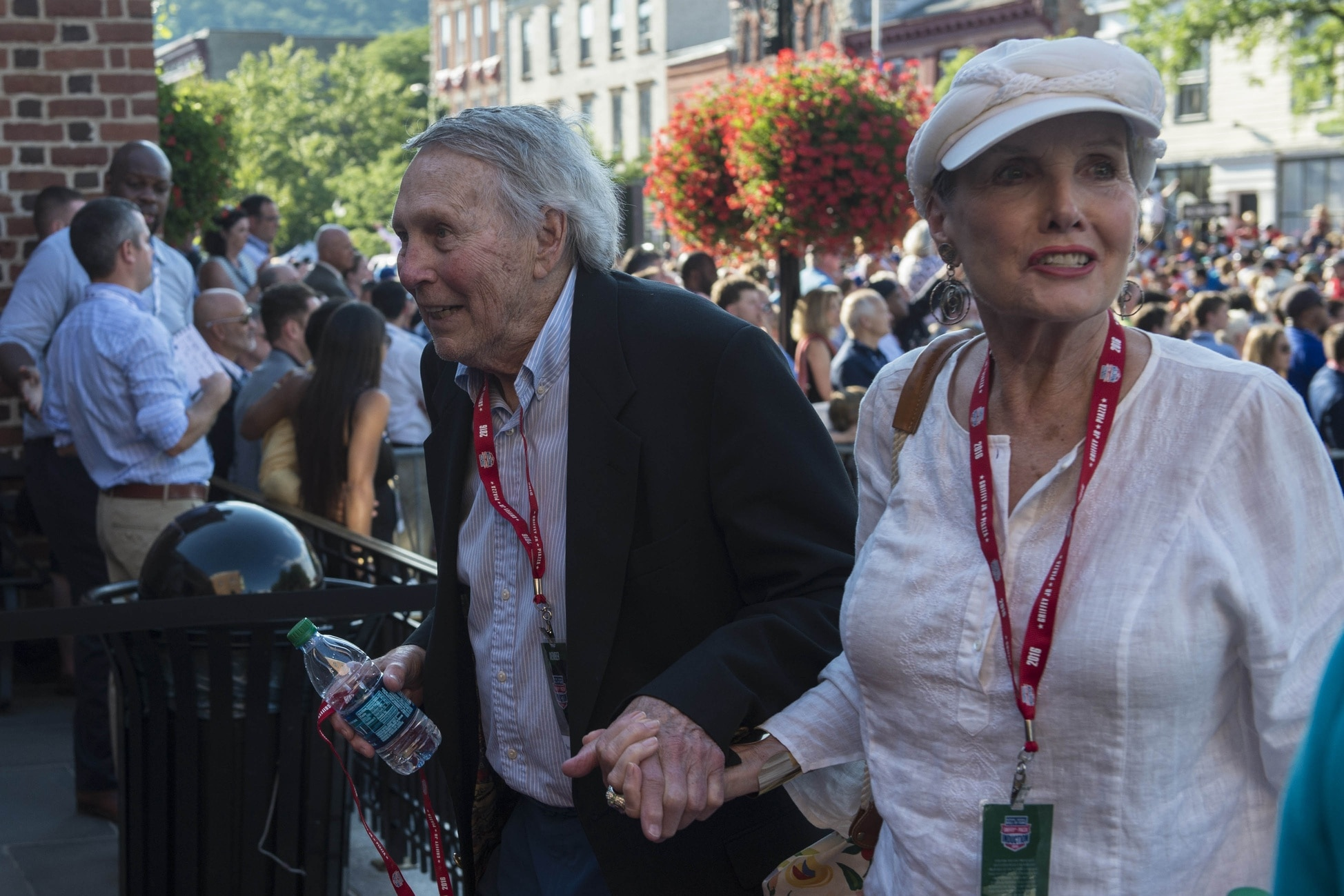 Caption: Jul 23, 2016; Cooperstown, NY, USA; Hall of Famer Brooks Robinson and his wife arrive at National Baseball Hall of Fame during the MLB baseball hall of fame parade of legends. Mandatory Credit: Gregory J. Fisher-USA TODAY Sports